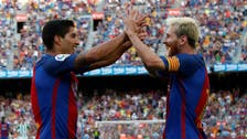 Suarez, Messi share 5 goals as Barca starts title defense