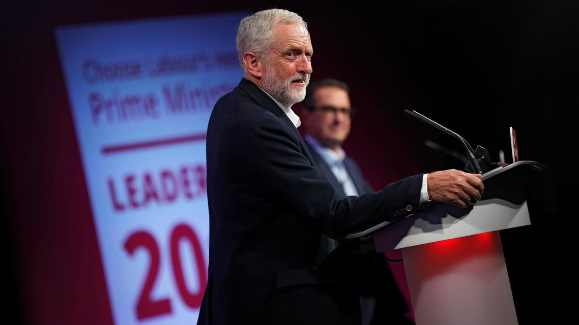 Labour Party leader Jeremy Corbyn (L) and challenger Owen Smith debate in a hustings event of the Labour leadership campaign in Birmingham, Britain, August 18, 2016. REUTERS