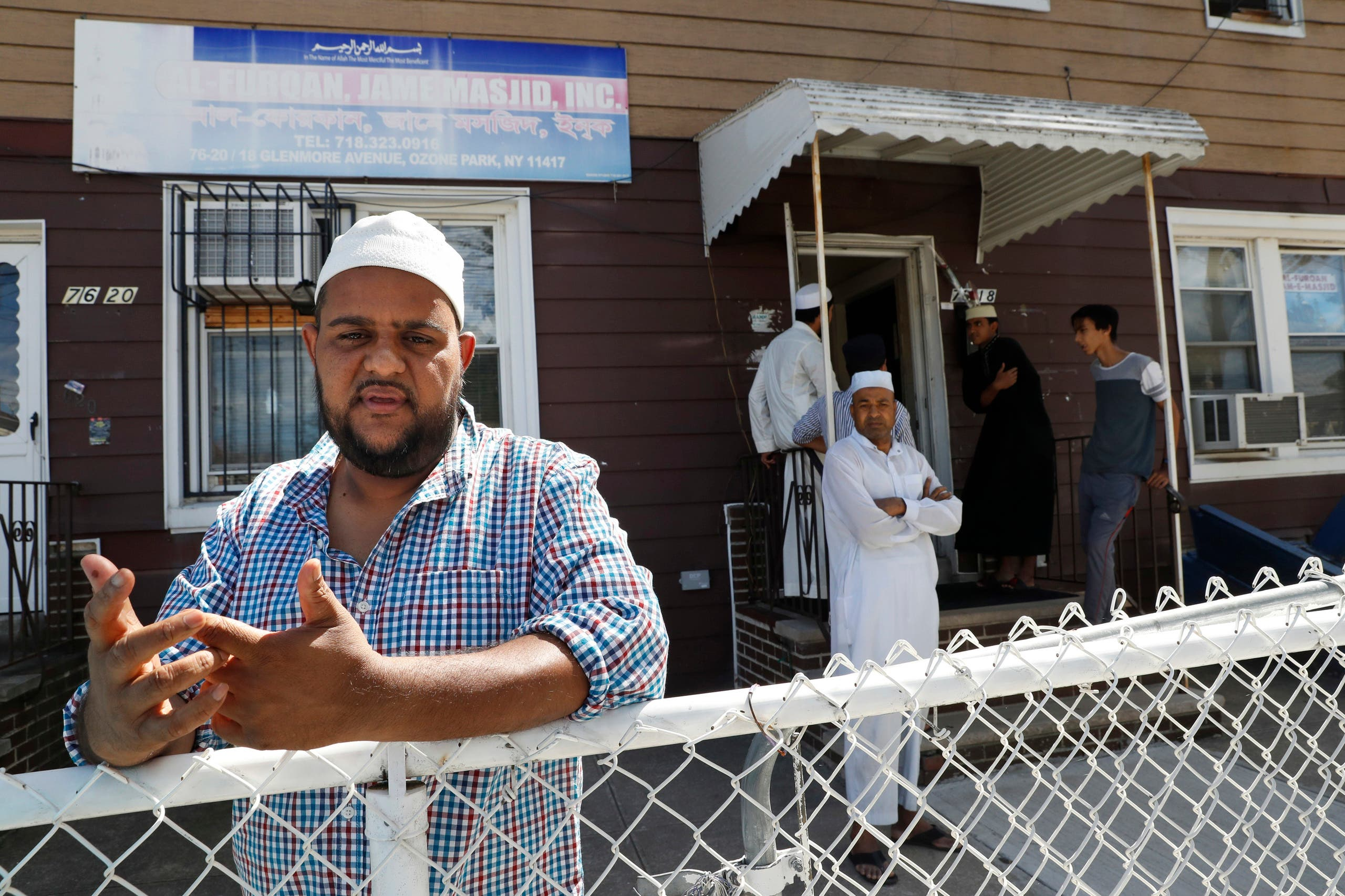 In this Wednesday, Aug. 17, 2016, photo Nurul Hoque gestures as he speaks during an interview with The Associated Press outside the Al-Furqan Jame mosque in the Ozone Park neighborhood of the Queens borough of New York. The shooting of an imam and his assistant near their New York mosque has unnerved Muslim residents of the Ozone Park section of Queens. (AP)