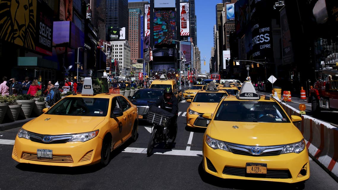 New York City taxi cabs drive through Times Square in New York March 29, 2016. REUTERS