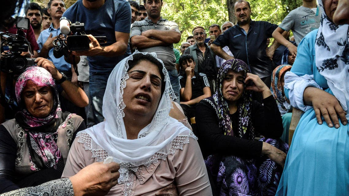 """Women cry during a funeral for a victim of last night's attack on a wedding party that left 50 dead in Gaziantep in southeastern Turkey near the Syrian border on August 21, 2016. At least 50 people were killed when a suspected suicide bomber linked to Islamic State jihadists attacked a wedding thronged with guests, officials said on August 21. Turkish President Recep Tayyip Erdogan said the IS extremist group was the """"likely perpetrator"""" of the bomb attack, the deadliest in 2016, in Gaziantep late Saturday that targeted a celebration attended by many Kurds. AFP"""