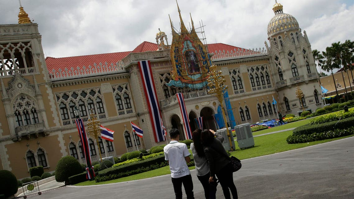 Thai reporters play Pokemon Go on their phone at a Government house in Bangkok, Thailand, Monday, Aug. 8, 2016. Two days after the highly anticipated Pokemon Go game was released in Thailand, officials have drawn up a list of places where Pokemon can't go. The royal palace is one of them. (AP)