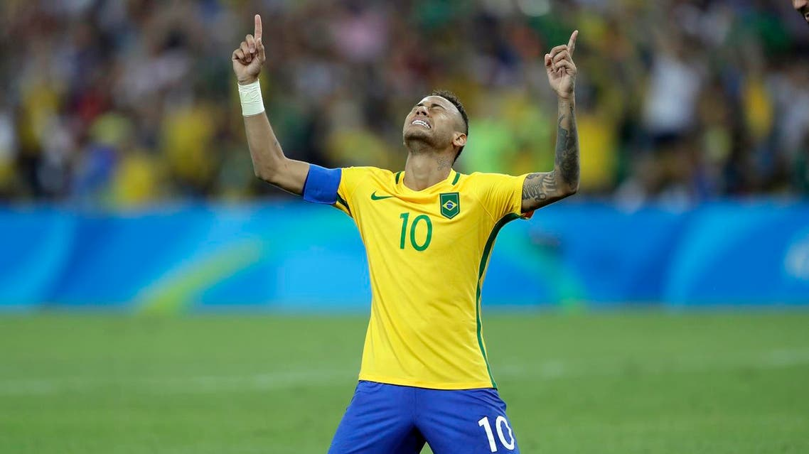 Brazil's Neymar cries as he kneels down to celebrate after scoring the decisive penalty kick during the final match of the men's Olympic football tournament between Brazil and Germany at the Maracana stadium in Rio de Janeiro, Brazil, Saturday Aug. 20, 2016. Brazil won the gold medal on a penalty shootout. (AP Photo/Andre Penner)