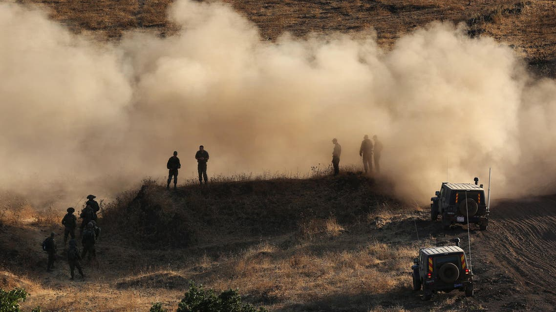 Israeli soldiers take part in a military exercise, which includes infantry, tanks and artillery units, in the northern part of the Israeli-annexed Golan Heights near the border with Syria on June 23, 2016. AFP
