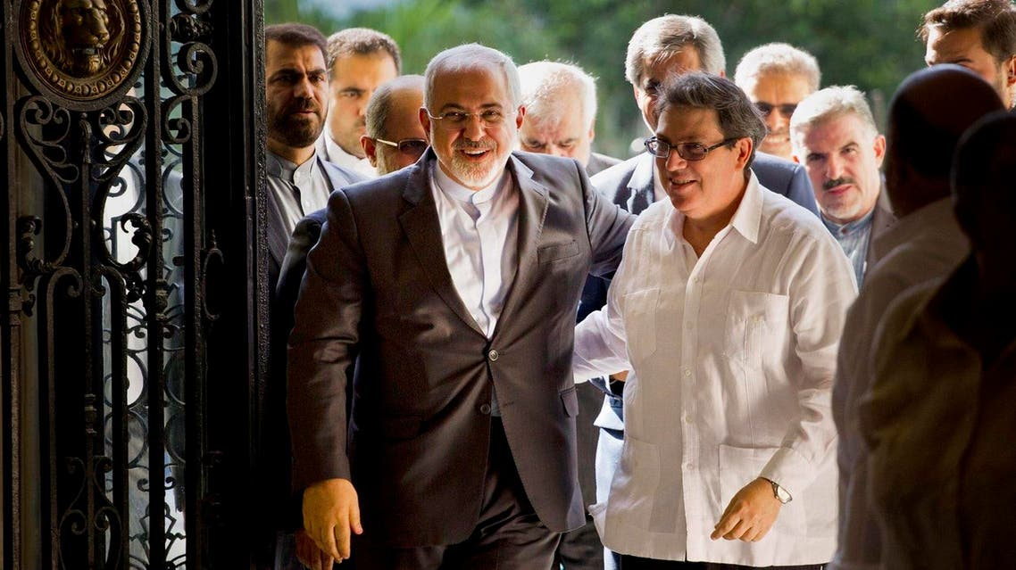 Iranian Foreign Minister Mohammad Javad Zarif, left, is welcomed by Cuban Foreign Minister Bruno Rodriguez, in Havana, Cuba. (AP)