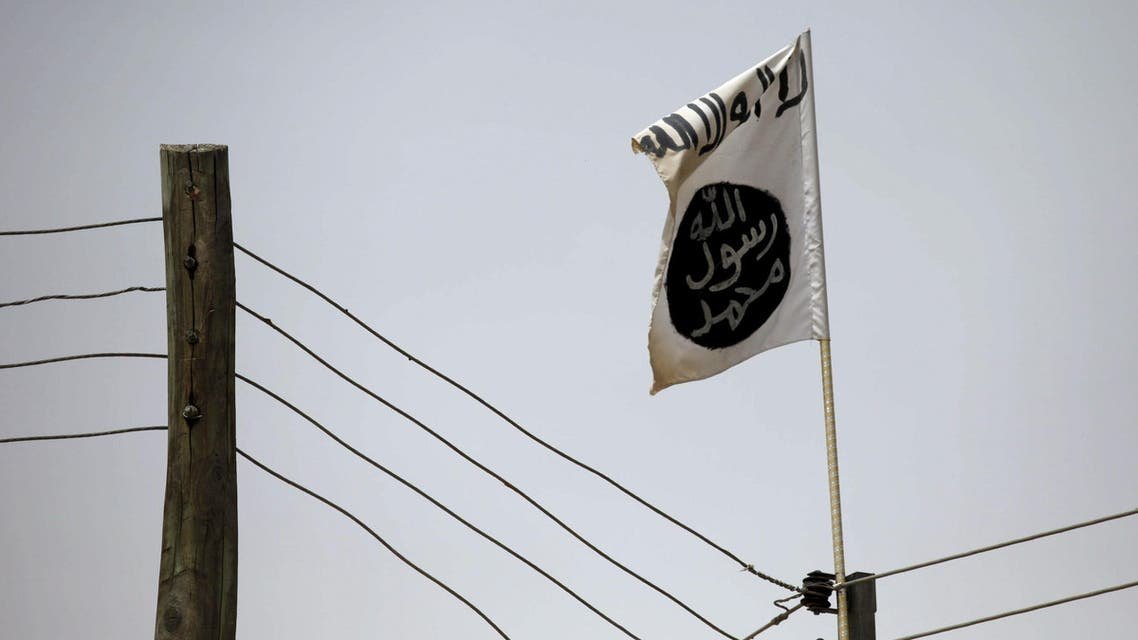 FILE PHOTO - A Boko Haram flag flies in Damasak, Nigeria March 24, 2015. REUTERS