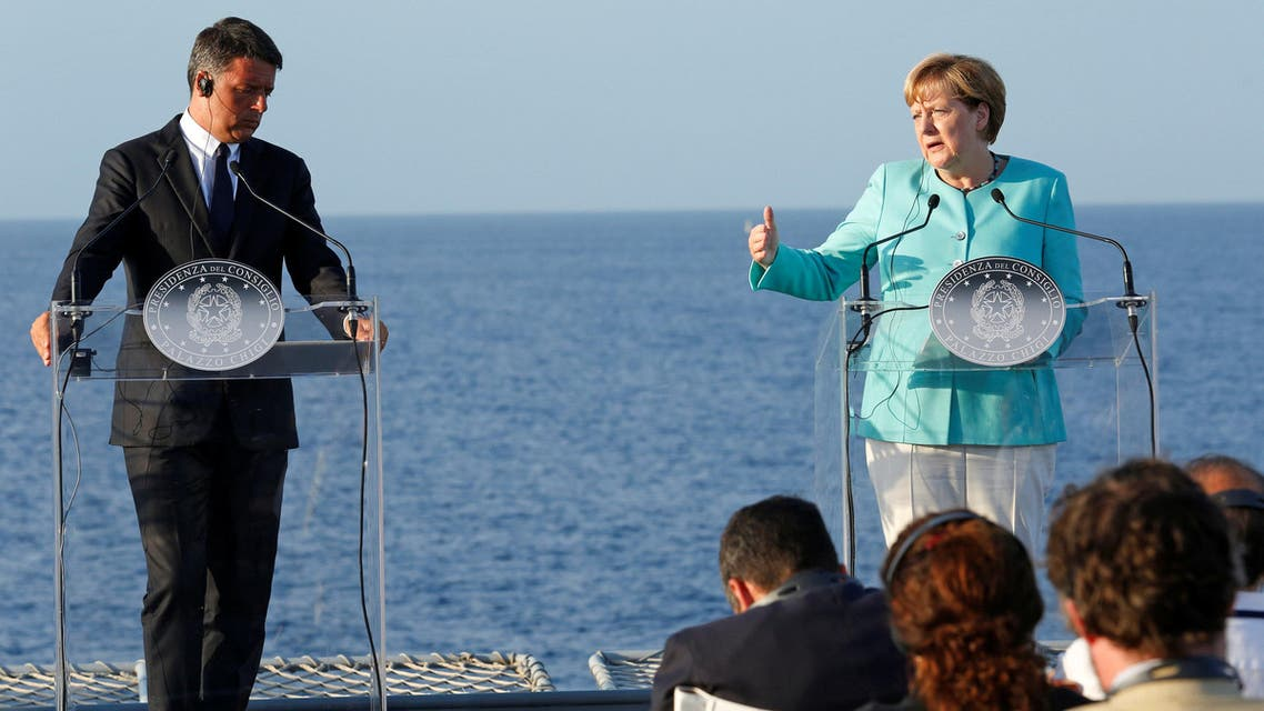 Italian Prime Minister Matteo Renzi, German Chancellor Angela Merkel (R) and French President Francois Hollande (not seen) lead a news conference on the Italian aircraft carrier Garibaldi off the coast of Ventotene island, central Italy, August 22, 2016. REUTERS