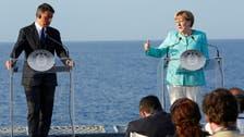Merkel backs Italian PM over EU budget rules