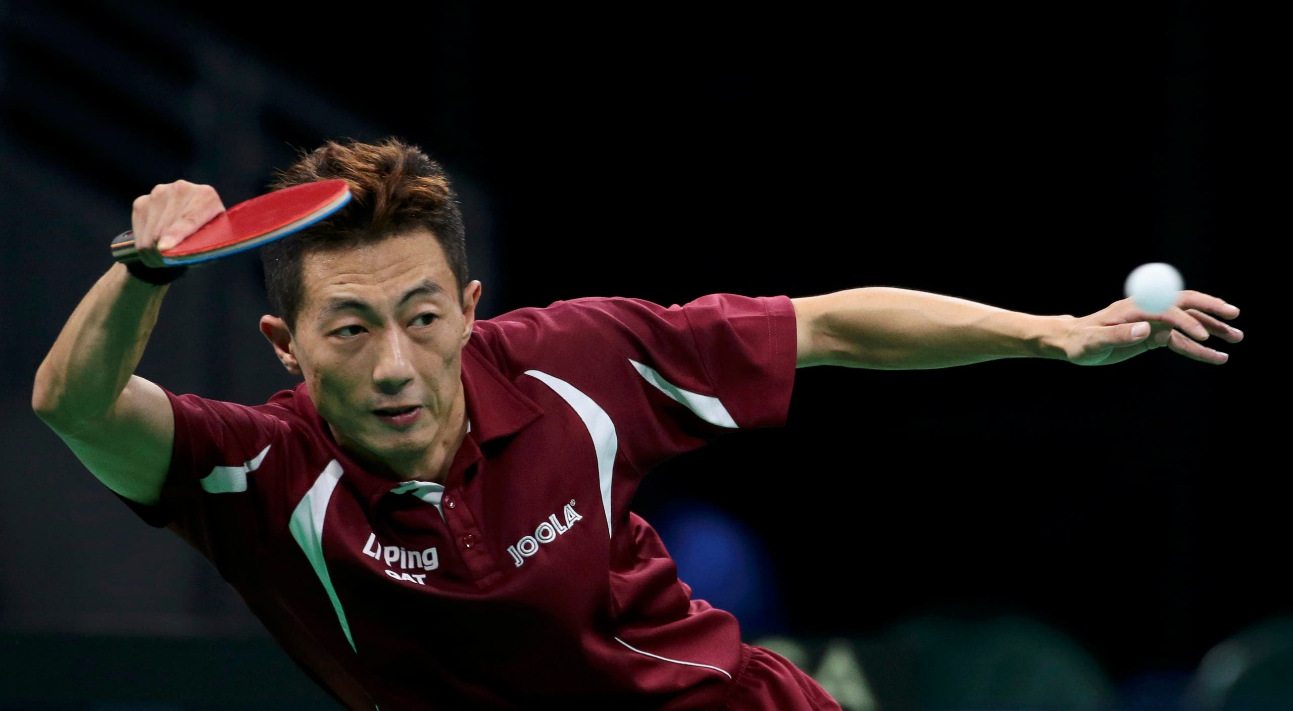Li Ping (QAT) of Qatar plays against Adam Pattantyus (HUN) of Hungary. REUTERS