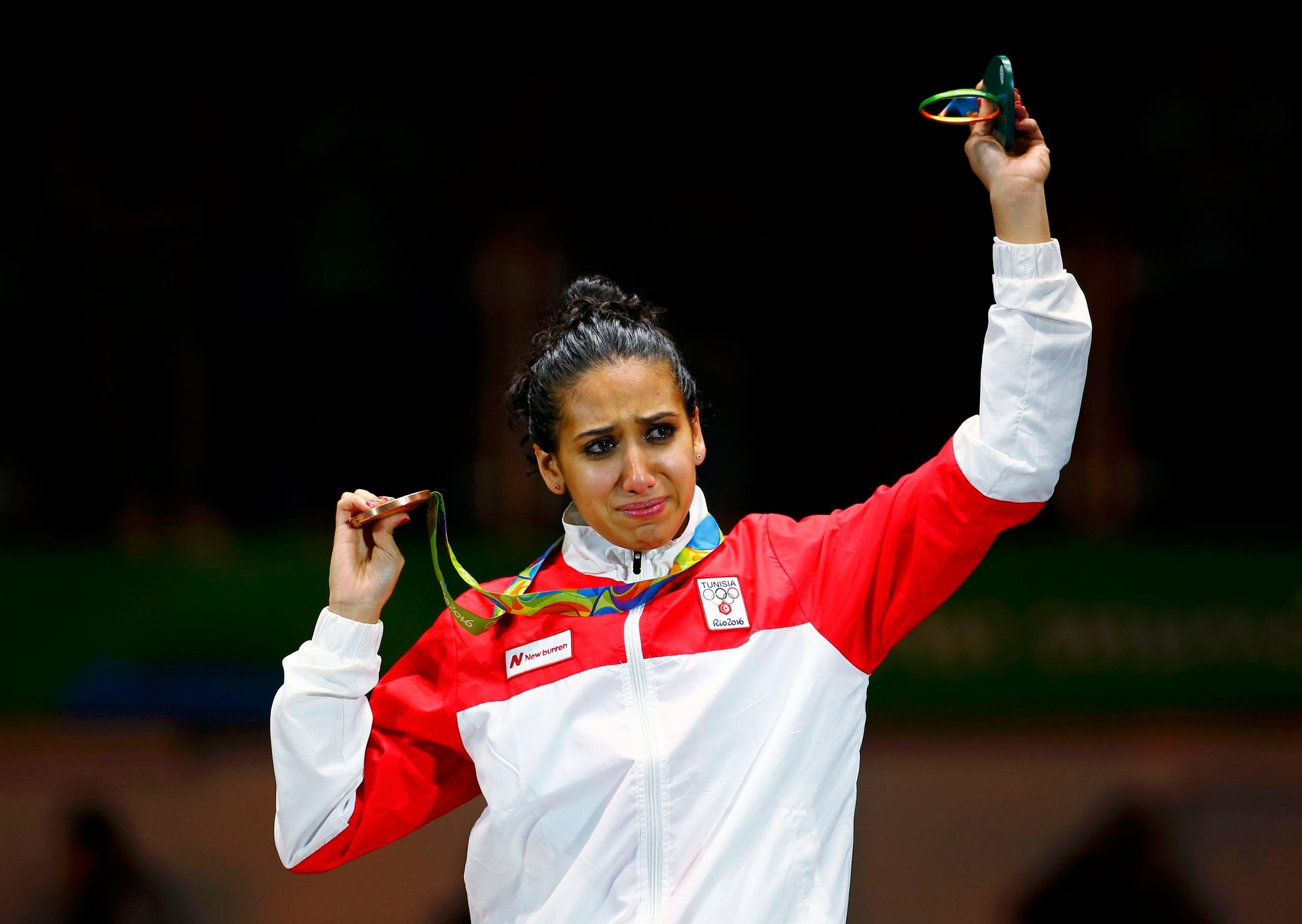 Ines Boubakri (TUN) of Tunisia celebrates winning the bronze medal. REUTERS