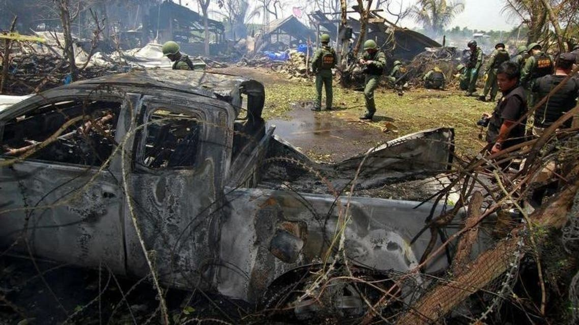 Thai soldiers inspect the scene of a car bomb blast outside a hotel in the southern province of Pattani, Thailand. (Reuters)