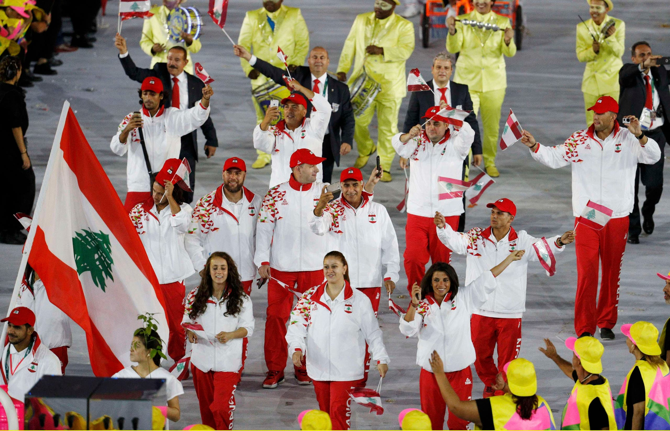 Flagbearer Nacif Elias (LIB) of Lebanon leads his contingent during the opening ceremony. REUTERS