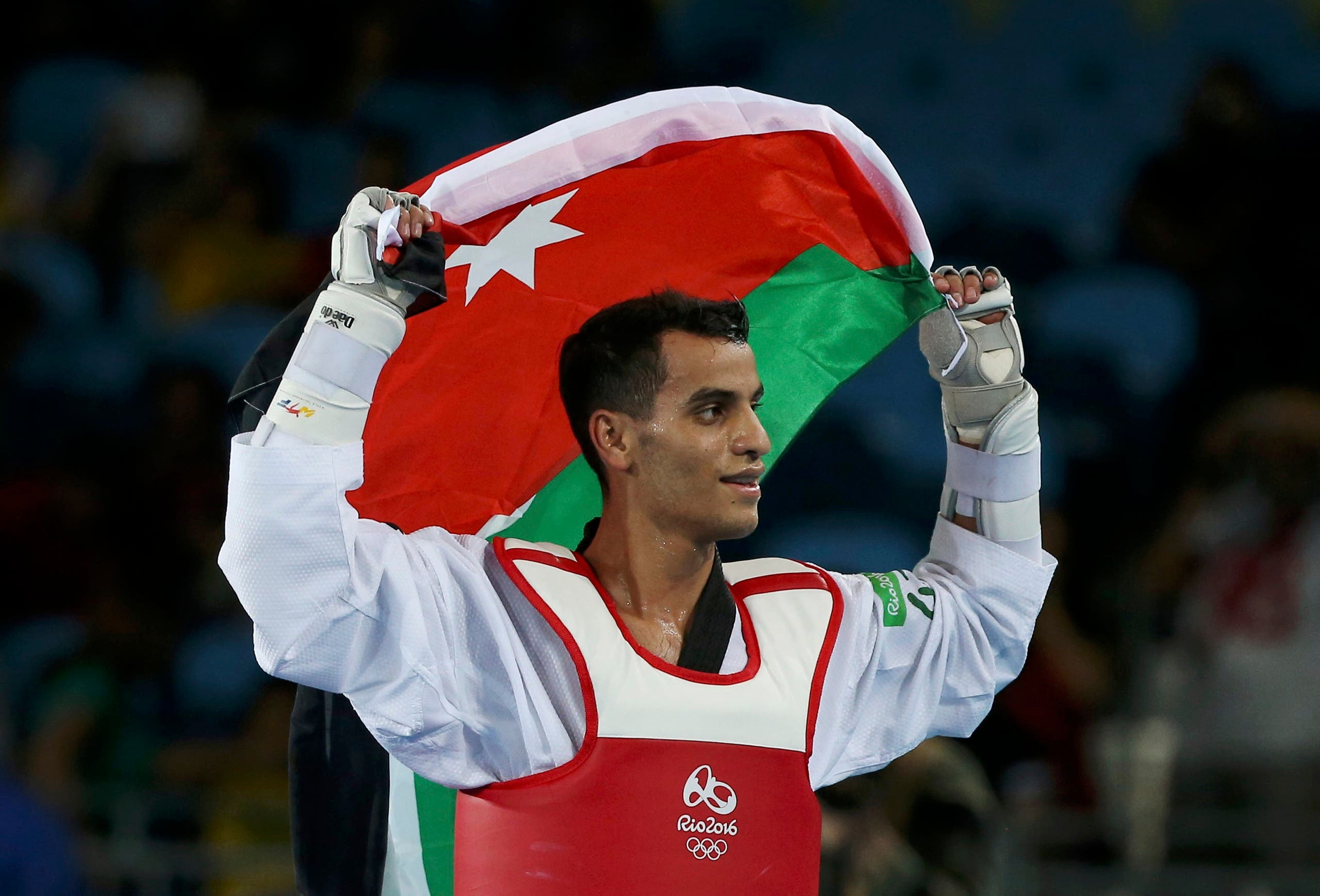 Ahmad Abughaush (JOR) of Jordan celebrates after defeating Alexey Denisenko (RUS) of Russia. REUTERS