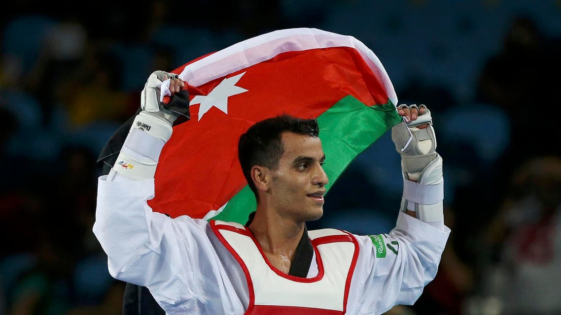 Ahmad Abughaush (JOR) of Jordan celebrates after defeating Alexey Denisenko (RUS) of Russia. REUTERS