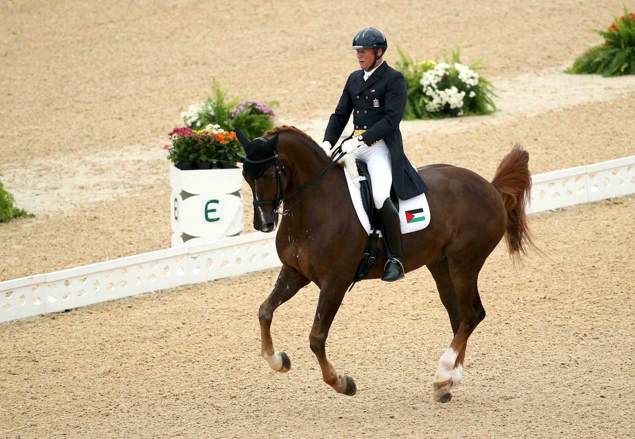 Christian Zimmermann (PLE) of Palestinian Territories riding Aramis 606 competes. (Reuters)