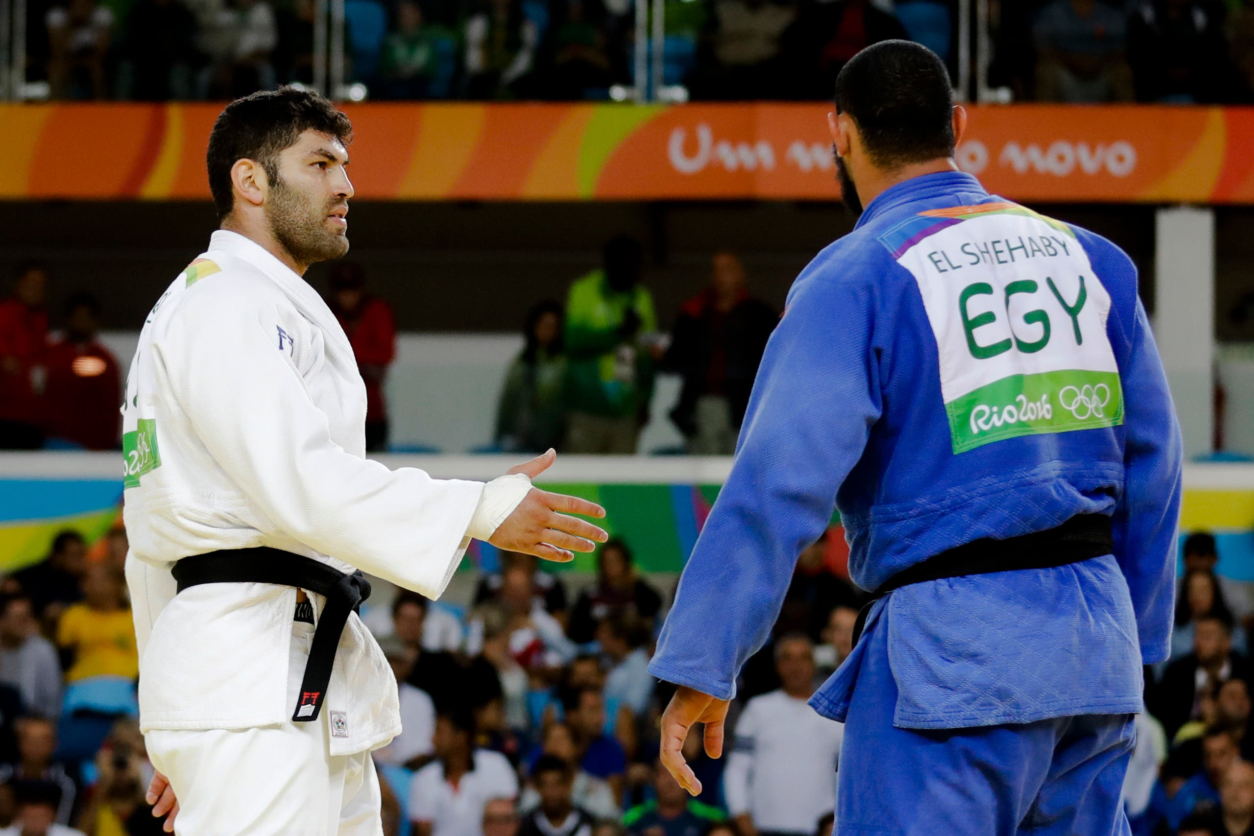 Egypt's Islam El Shehaby, blue, declines to shake hands with Israel's Or Sasson, white, after losing during the men's over 100-kg judo competition at the 2016 Summer Olympics in Rio de Janeiro, Brazil, Friday, Aug. 12, 2016. (AP