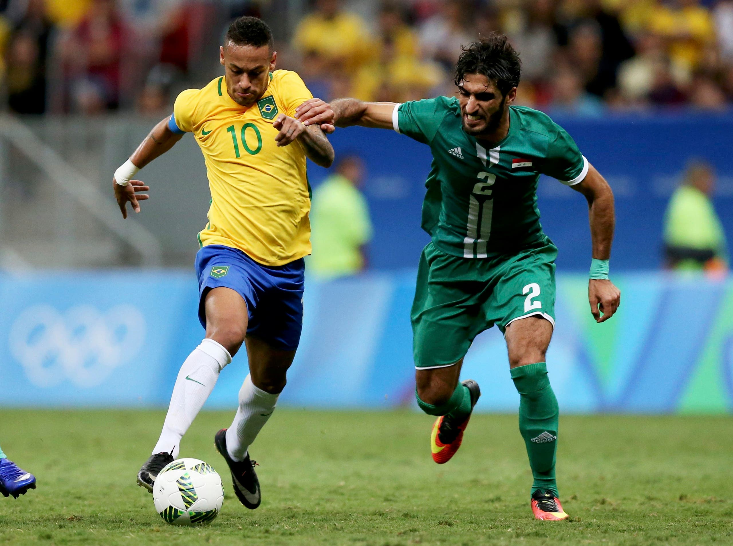 Neymar (BRA) of Brazil looks for an opening against the defense of Ahmed Ibrahim (IRQ) of Iraq in the first half. REUTERS