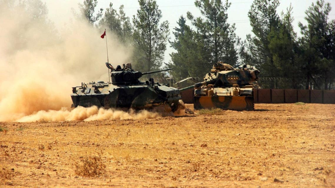 A Turkish army tank and an armoured vehicle are stationed near the Turkish-Syrian border in Karkamis in the southeastern Gaziantep province. (Reuters)