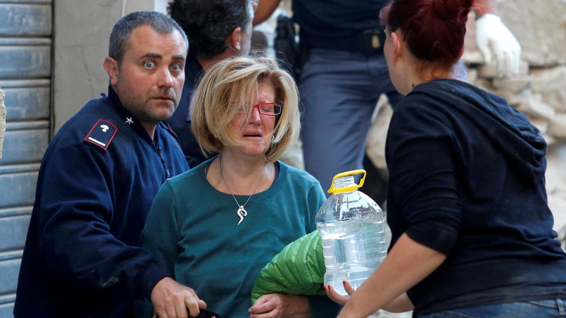 A woman cries after been rescued from her home following a quake in Amatrice. (Reuters)