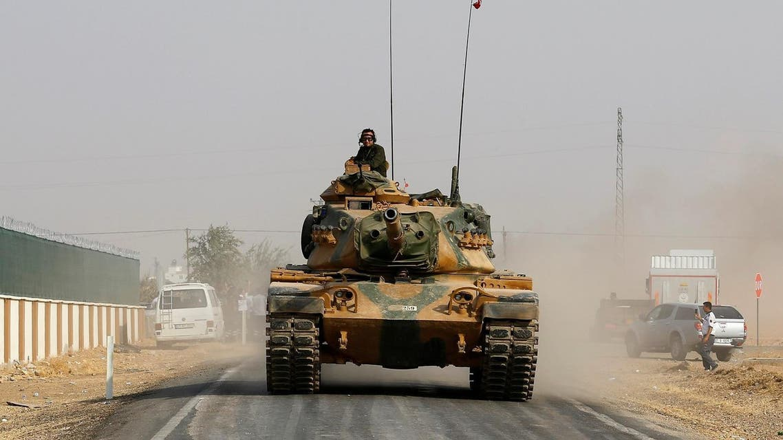 A Turkish army tank drives towards to the border in Karkamis on the Turkish-Syrian border in the southeastern Gaziantep province. (Reuters)