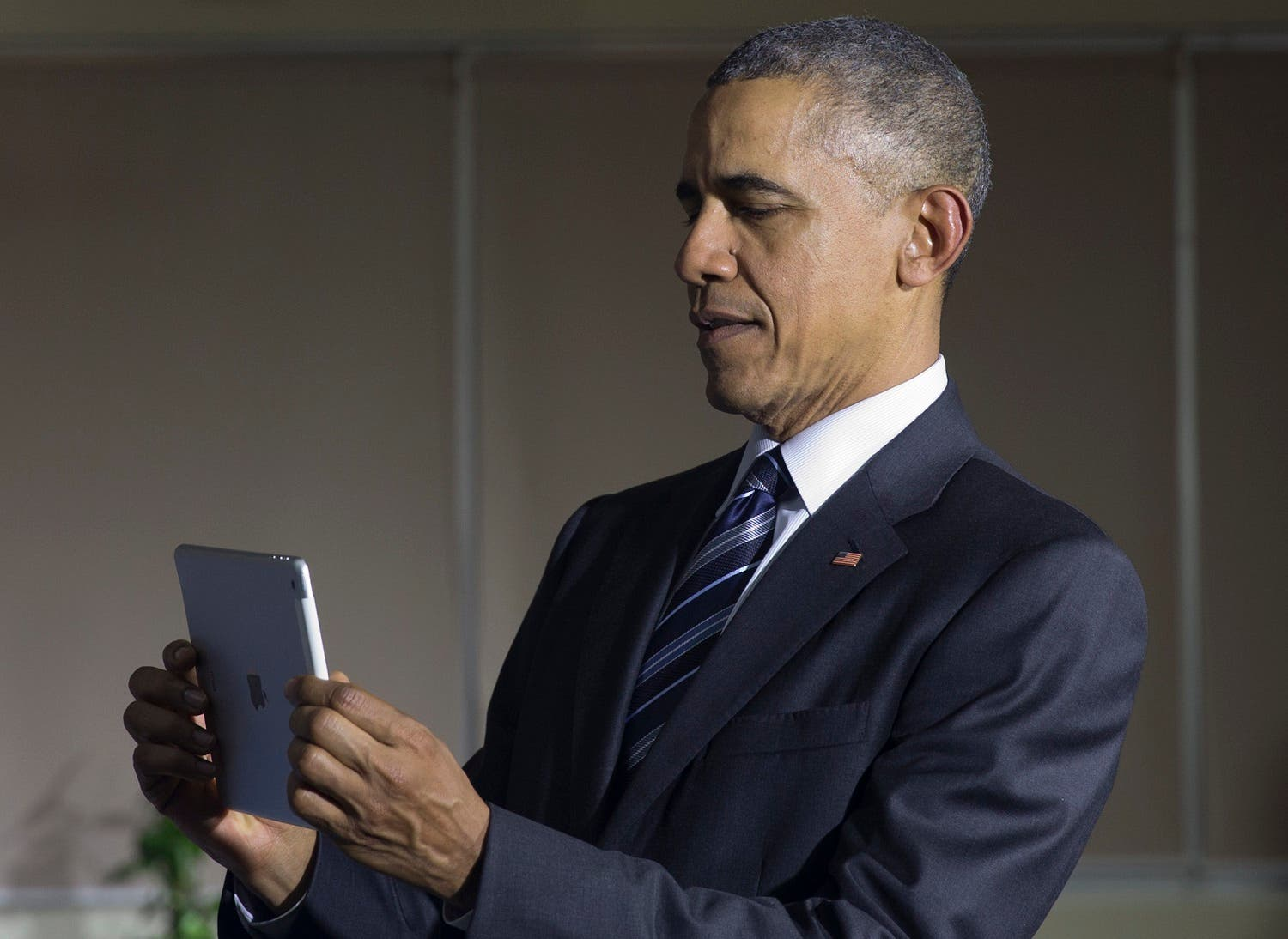 Today, President Barack Obama gets his daily briefings on his iPad; they include graphics, videos and previous articles. (AP)