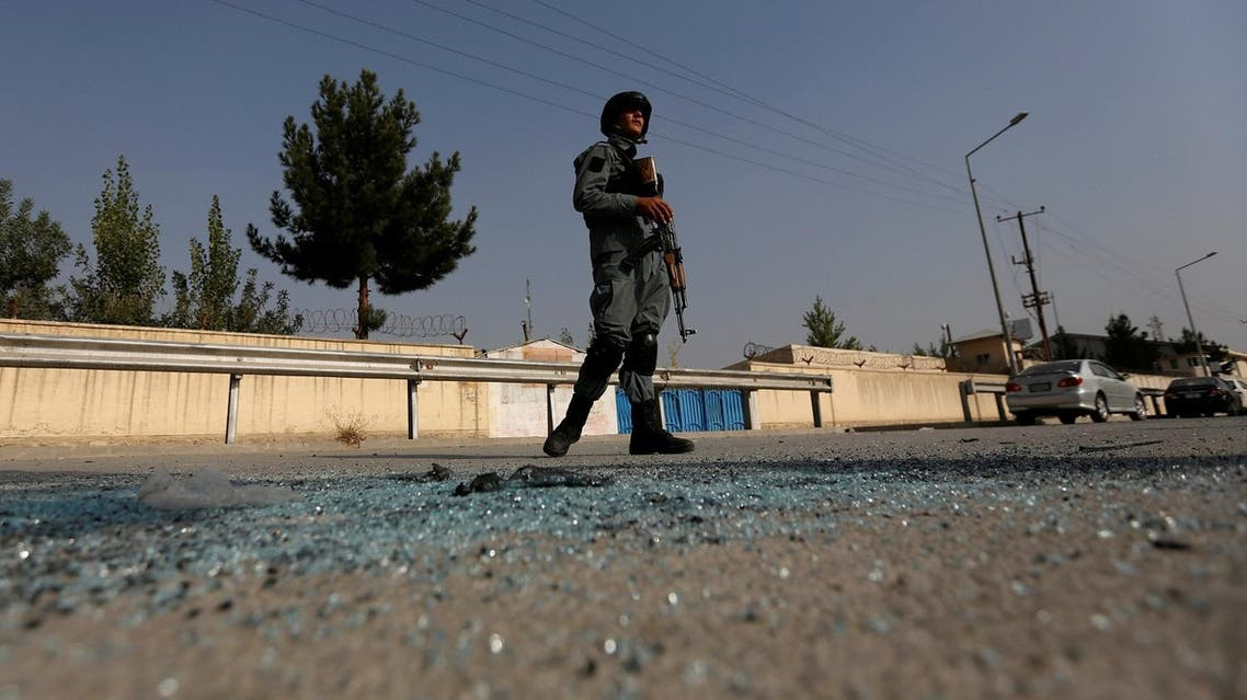 An Afghan policeman stands guard after an attack at the American University of Afghanistan in Kabul. (Reuters)