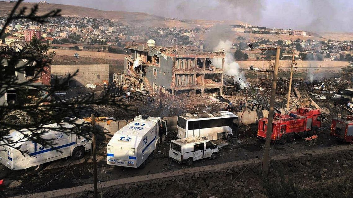 Smoke still rises from the scene after Kurdish militias attacked a police checkpoint in Cizre, southeast Turkey, Friday, Aug. 26, 2016, with an explosives-laden truck, killing many (Photo: DHA via AP)