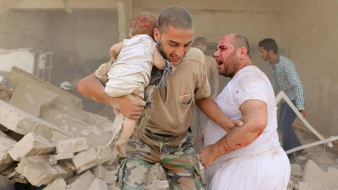 A Syrian man carries a wounded child following a barrel bomb attack on the Bab al-Nairab neighbourhood of the northern Syrian city of Aleppo on August 25, 2016. (AFP)