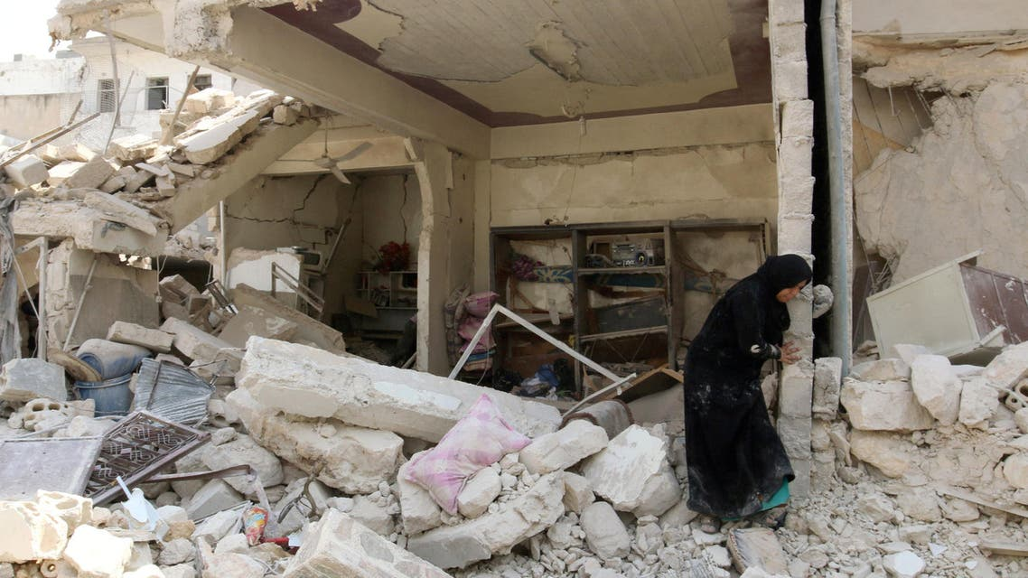 A woman inspects the damage after an airstrike in the rebel held Bab al-Nairab neighborhood of Aleppo, Syria, August 25, 2016. Reuters