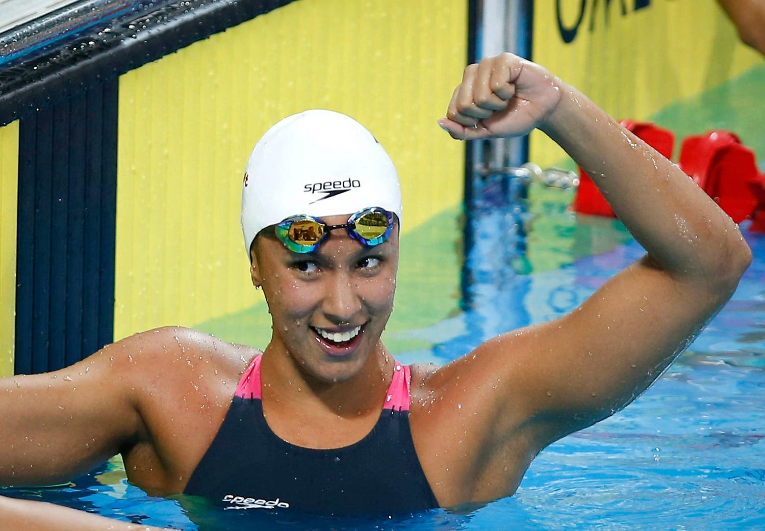 Jasmine al-Khaldi from the Philippines celebrates after winning the women's 100- meter freestyle during the 27th Southeast Asian (SEA) Games in Naypyitaw, Myanmar, Thursday, Dec. 12, 2013. (AP)
