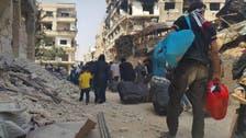 تصاویر: شامی شہر داریا میں پھنسے شہریوں اور باغیوں کے انخلا کا آغاز