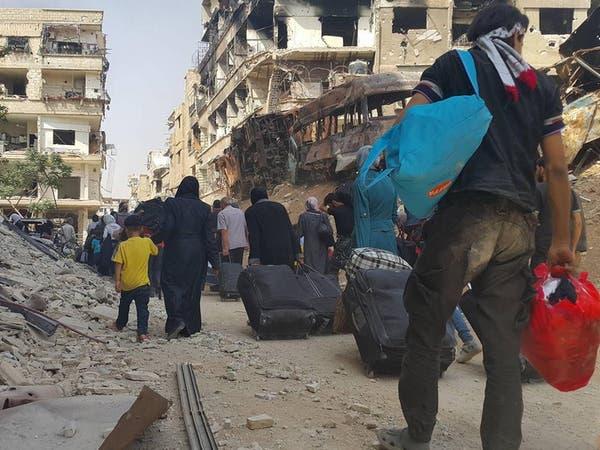 بالصور.. إجلاء أول دفعة من المدنيين المحاصرين في داريا