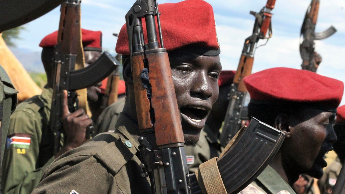 In this photo taken Thursday, April 14, 2016, government soldiers follow orders to raise their guns during a military parade in Juba, South Sudan. When South Sudan's president signed a peace deal a year ago to end the country's civil war he added 16 reservations to the agreement, which have now become a map of how it has unraveled. (Photo: AP))