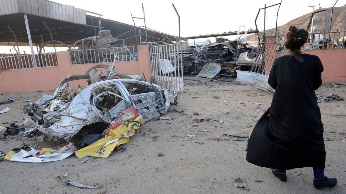A foreign female journalist films damage at a market for vehicles on August 27, 2016 in the Saudi border city of Najran, a week after it was struck by a rocket fired from Yemen. Cross-border attacks into Saudi Arabia have intensified since the suspension in early August of UN-brokered peace talks between the Shiite Huthi rebels and their allies, and Yemen's internationally-recognised government which has the military support of a Saudi-led Arab coalition. FAYEZ NURELDINE / AFP
