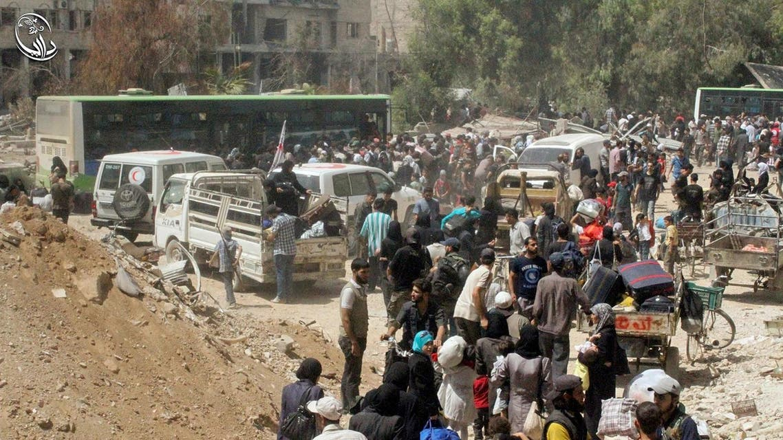 This photo provided by the Syrian anti-government activist group Local Council of Daraya City, which has been authenticated based on its contents and other AP reporting, shows Syrian citizens gather with their belonging as they prepare to evacuate from Daraya, a blockaded Damascus suburb, on Friday, Aug. 26, 2016. The development in the Daraya suburb is part of an agreement struck between the rebels and the government of President Bashar Assad. Rebels agreed to evacuate after four years of grueling bombardment and a crippling siege that has left the sprawling suburb southwest of the capital in ruins.(Local Council of Daraya City via AP)