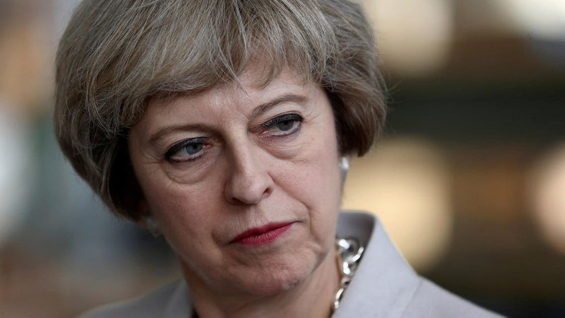 Britain's Prime Minister Theresa May visits a joinery factory in London (Photo: Reuters)