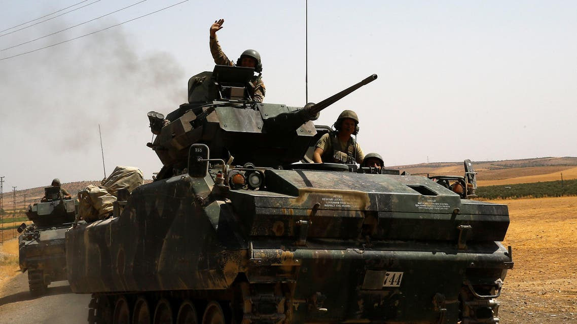 A Turkish soldier on an armoured personnel carrier waves as they drive from the border back to their base in Karkamis on the Turkish-Syrian border in the southeastern Gaziantep province, Turkey, August 27, 2016. (Reuters)