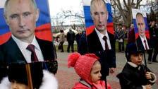 Putin re-writes Russian history as Ukraine celebrates a milestone