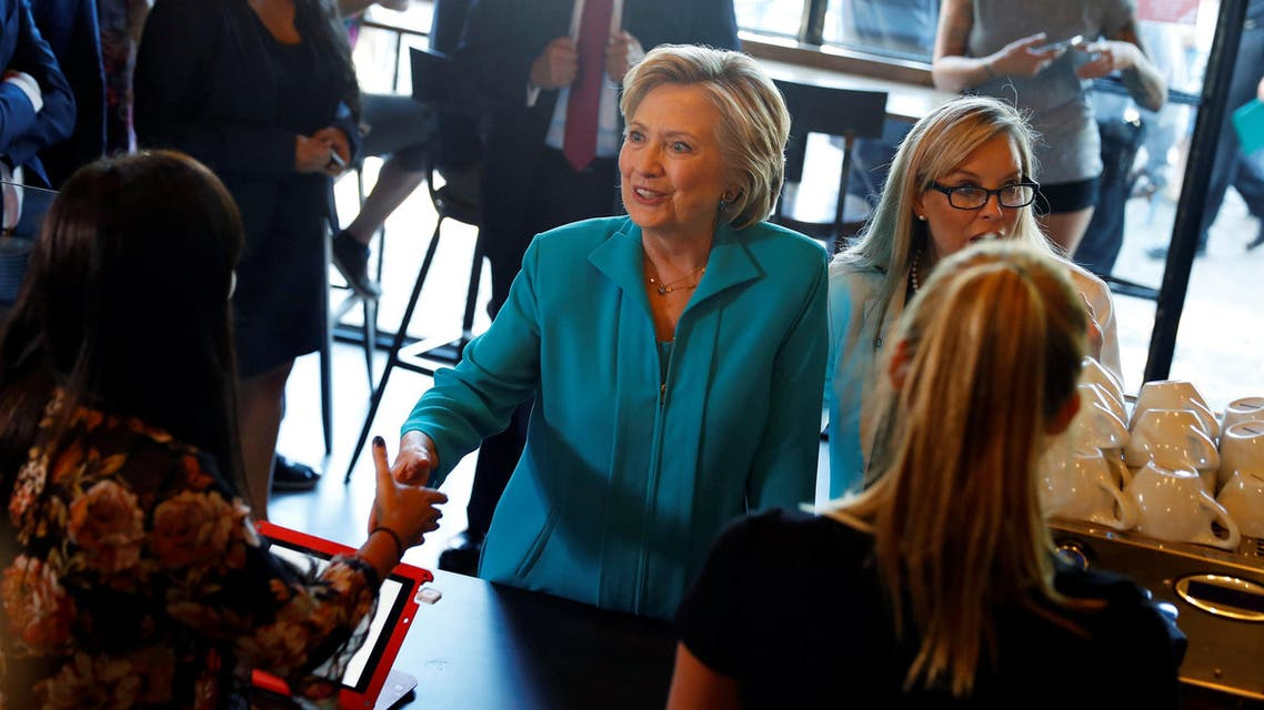 Democratic presidential nominee Hillary Clinton greets supporters at Hub Coffee Roasters in Reno, Nevada, August 25, 2016. REUTERS