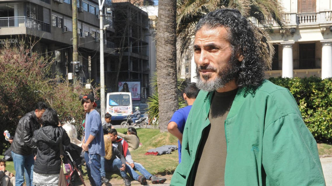 Former Guantanamo inmate Syrian Jihad Ahmed Mustafa Diyab walks in front of Syrian refugees as they camp at Independence square in Montevideo to demonstrate on September 8, 2015. (AFP)
