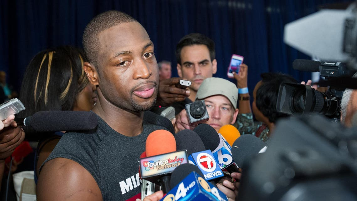 Miami Heat point guard Dwayne Wade speaks to reporters during a break from a training camp session at the Atlantis Resort in Paradise Island, Bahamas, Tuesday, Oct. 1, 2013. AP