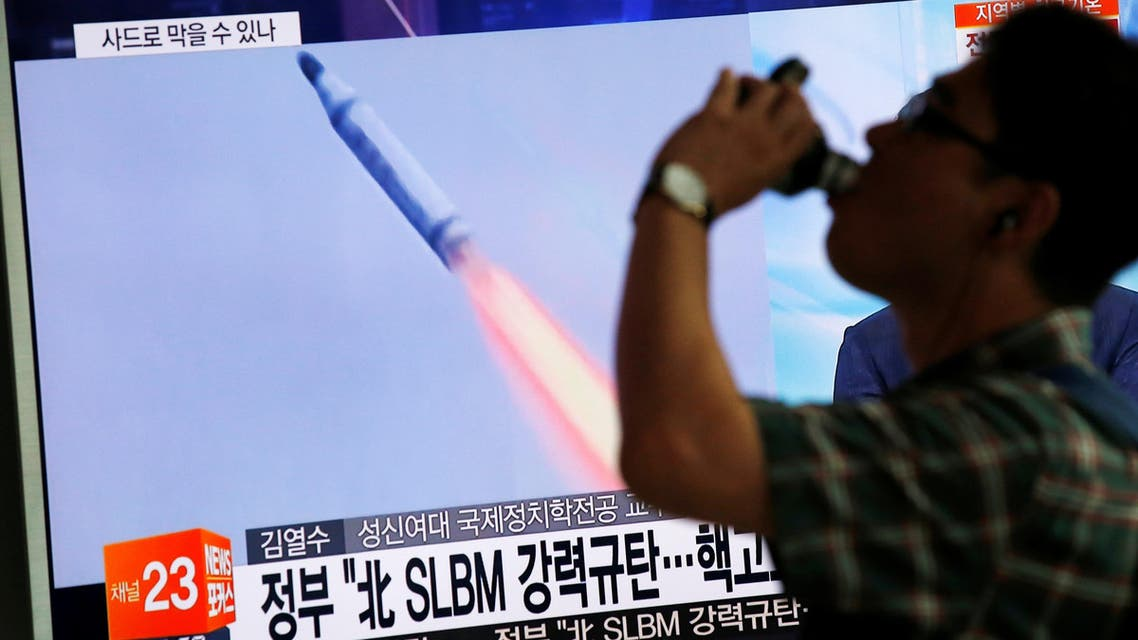 A passenger walks past a TV screen broadcasting a news report on North Korea's submarine-launched ballistic missile fired from North Korea's east coast port of Sinpo, at a railway station in Seoul, South Korea, August 24, 2016 REUTERS