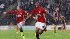 Late show helps Mourinho's United join Chelsea on top