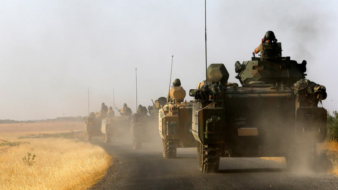Turkish armoured personnel carriers drive towards the border in Karkamis on the Turkish-Syrian border in the southeastern Gaziantep province, Turkey, August 27, 2016. REUTERS