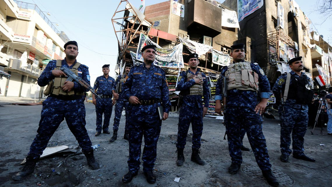 Iraqi security forces guard at the site of a suicide car bomb attack, in Baghdad, Iraq July 10, 2016. Picture taken July 10, 2016. REUTERS/Ahmed Saad