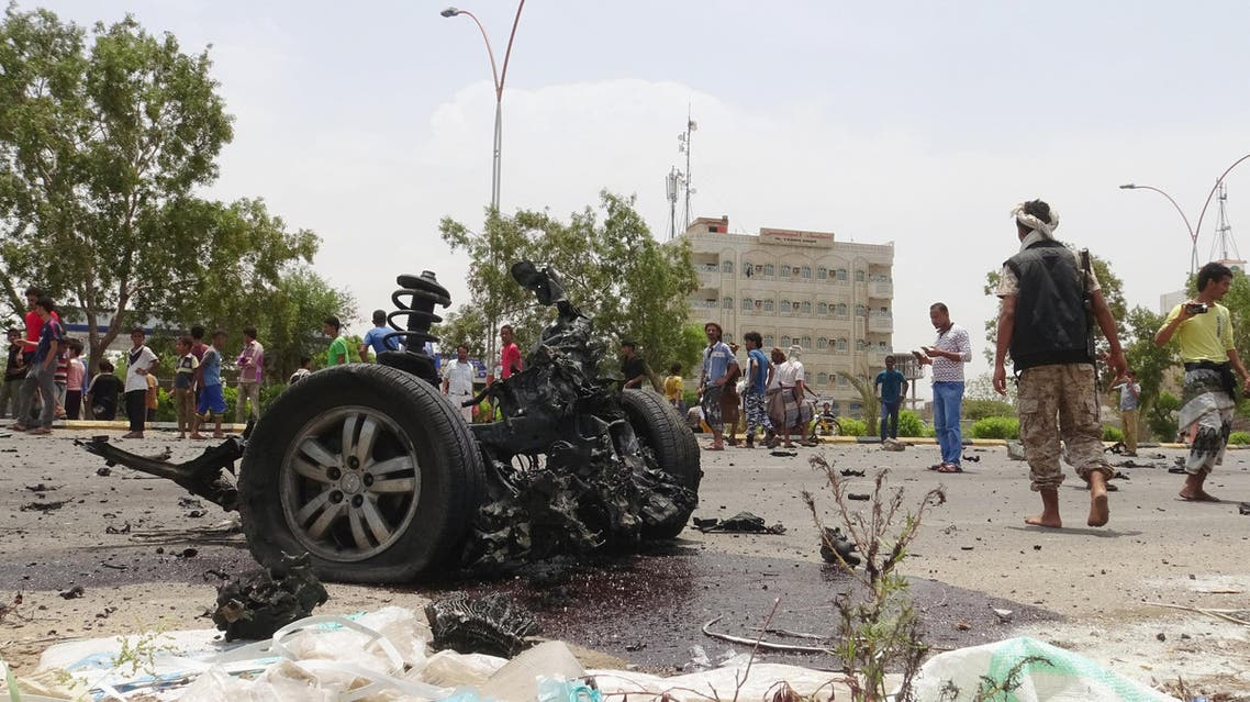 Members of the Southern Resistance militia gather at the site of a car bomb attack in the southern port city of Aden, Yemen July 31, 2016. REUTERS