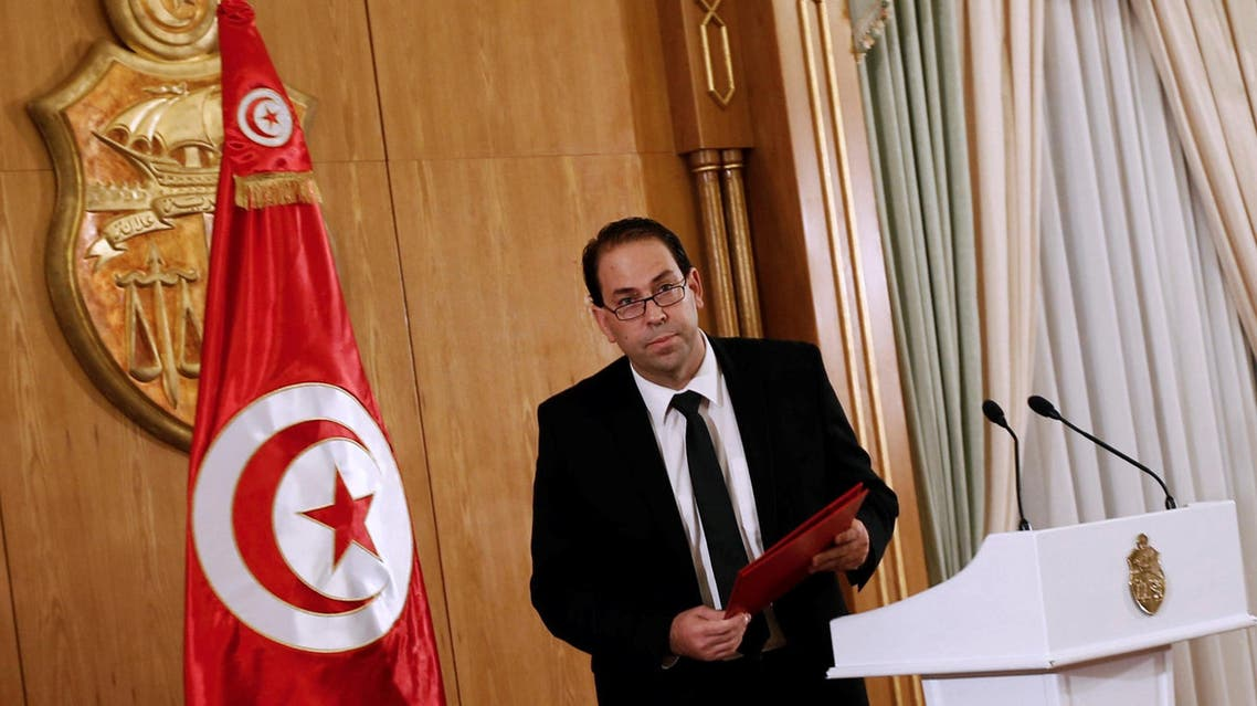 Tunisia's Prime Minister-designate Youssef Chahed leaves after a news conference in Tunis. (Reuters)