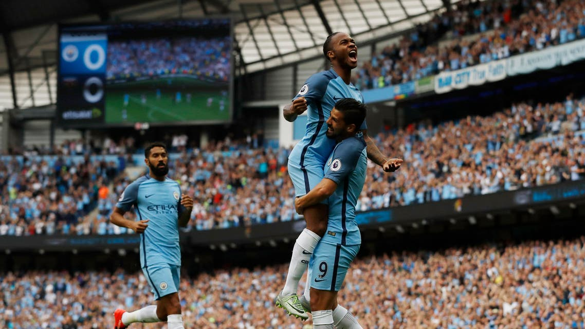 Manchester City's Raheem Sterling celebrates scoring their first goal. reuters