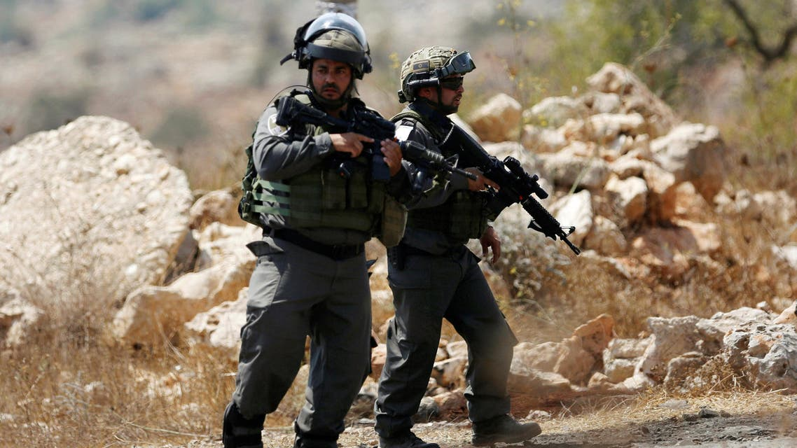 Israeli border policemen stand guard at the scene where a Palestinian was shot and killed by Israeli forces in the West Bank village of Silwad near Ramallah August 26, 2016. REUTERS