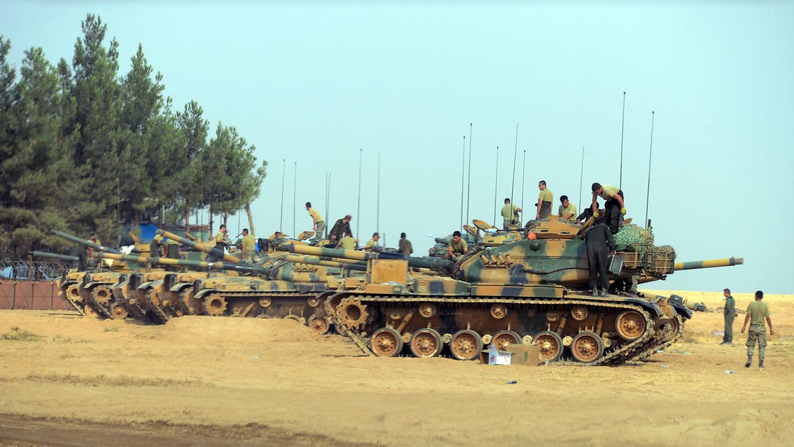 Turkish troops check their tanks near the Syrian border, in Karkamis, Turkey, Friday, Aug. 26, 2016. AP